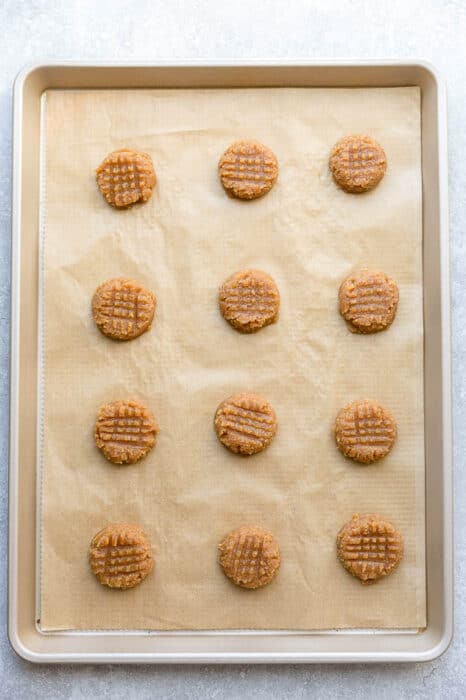Top view of unbaked keto peanut butter cookies on a baking sheet