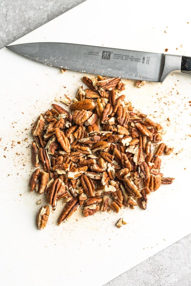 Chopped pecans with a knife