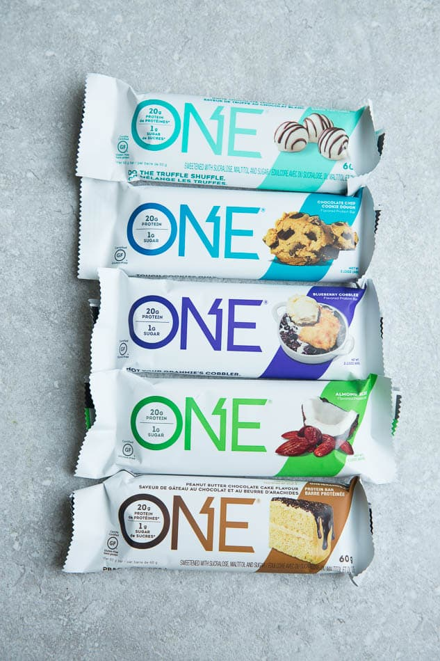 Top view of five One Protein Bars on a grey background