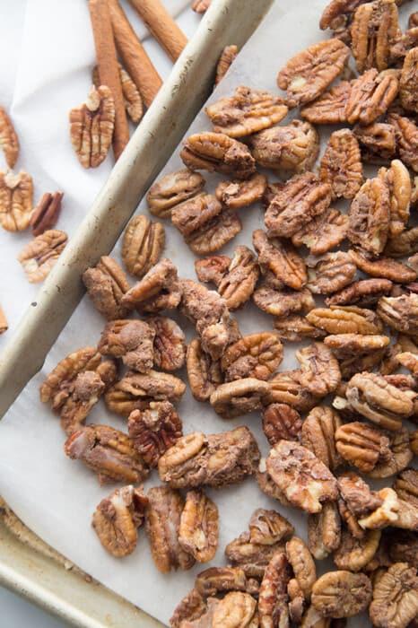Top view of vegan roasted pecans on a baking sheet