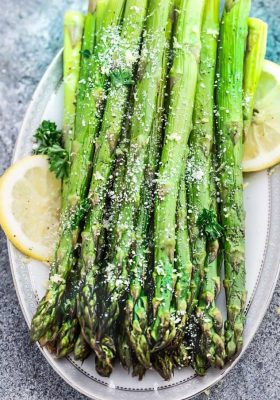 Lemon Parmesan Roasted Asparagus is the perfect quick and easy side dish for holidays or any night of the week. Best of all, this recipe only requires 5 minutes of prep with fresh lemon juice, garlic and Parmesan.