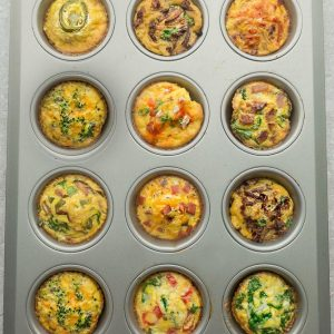 9 Breakfast Egg Muffin Cups are the perfect easy make-ahead breakfast for on the go. Best of all, they are packed with protein and so convenient for busy mornings, weekend or holiday brunch! Broccoli and Cheddar Cheese, Buffalo Chicken, Ham and Cheddar Cheese, Jalapeno Popper, Kimchi, Mushroom, Pepper and Spinach, Sun-Dried Tomato and Spinach, Tomato, Basil and Parmesan