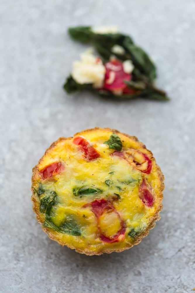 1 Tomato Spinach and Parmesan Breakfast Egg Muffin - front view