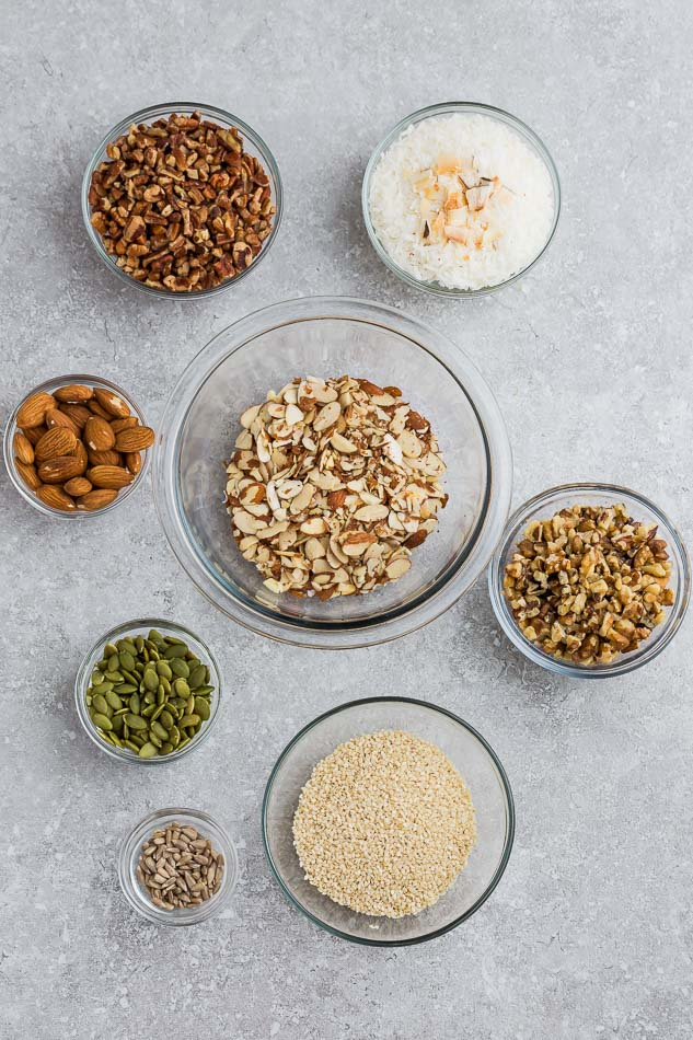 Top view of ingredients to make keto granola bars on a grey background