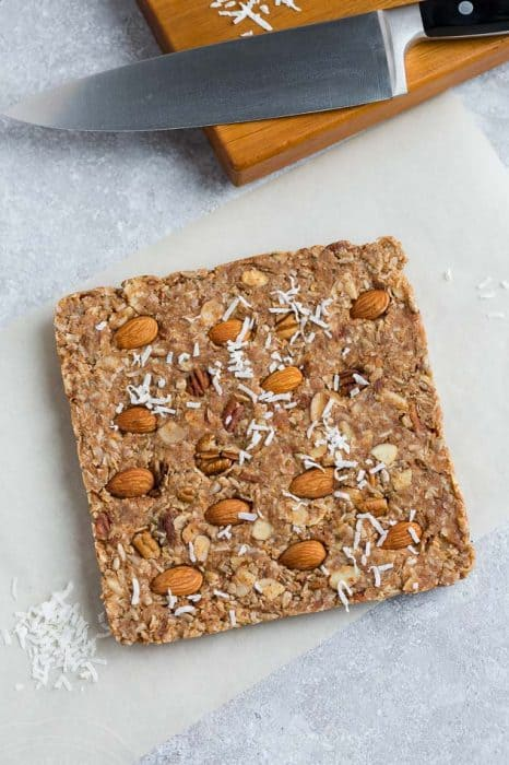 Top view of uncut 4 low carb granola bars on a grey background