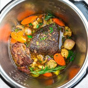The Bowl of an Instant Pot Containing Beef and Vegetables