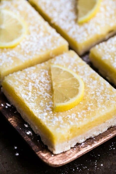 1 Keto Low Carb Lemon Bars on a brown square plate