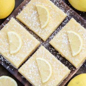 4 Keto Low Carb Lemon Bars on a brown square plate