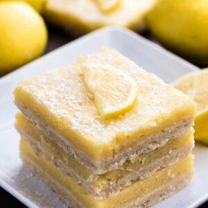 Stack of 3 Keto Lemon Bars on a white square plate