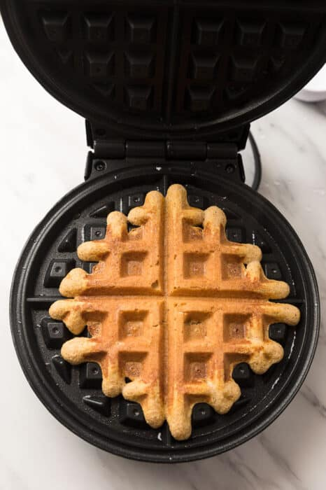 Top view of cooked keto pumpkin waffles in a Belgian Waffle maker
