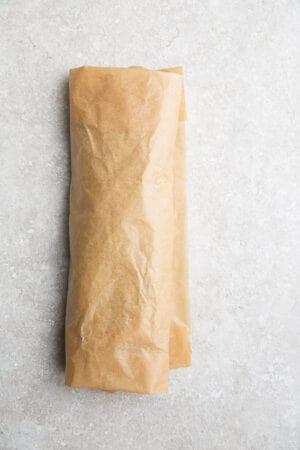 Top view of a low carb lettuce wrap sandwich using brown parchment paper