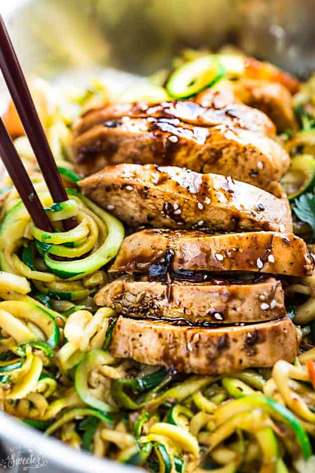 Close-up view of Low Carb Zucchini Noodles with Chicken in a pan with chopsticks