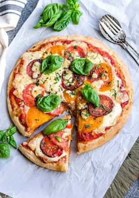 Margherita Pizza - a simple classic recipe that's made with Heirloom tomatoes, mozzarella and fresh basil. Easy and perfect for busy weeknights. Best of all, simple to customize with your favorite toppings