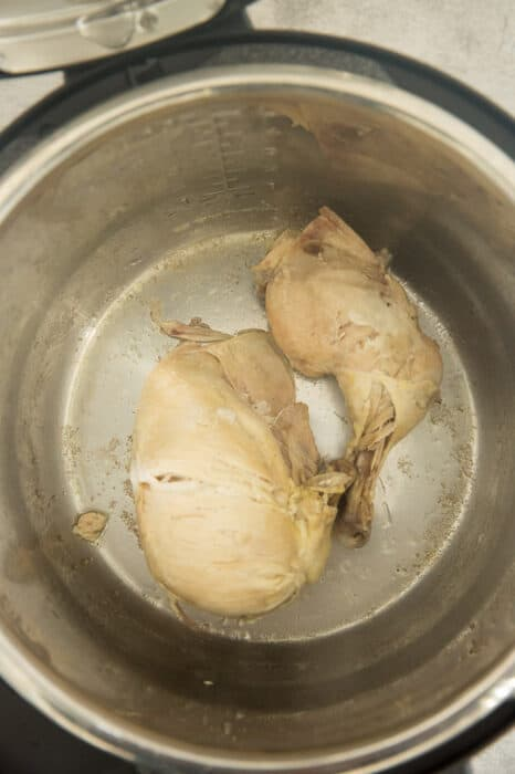 Overhead view of cooked chicken legs in a Mealthy Multipot