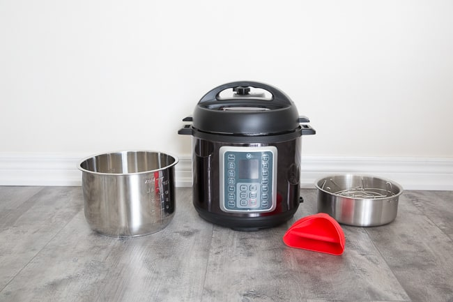 Mealthy Multipot with its cooking accessories next to it