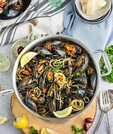 Steamed Mediterranean PEI Mussels are the perfect easy 30 minute meal or appetizer. Best of all, a simple & elegant dish for entertaining.