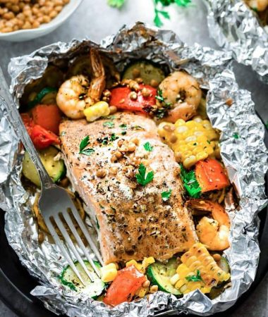This recipe for Mediterranean Salmon Foil Packets with Lentils is a quick, healthy and tasty 30 minute meal. A fresh and flavorful dish made with summer veggies and protein packed lentils - these are perfect for busy summer nights, camping and cookouts. Best of all, clean-up is a breeze with virtually no dishes and a tasty Sunday meal prep to pack into your school or work lunches for the week!