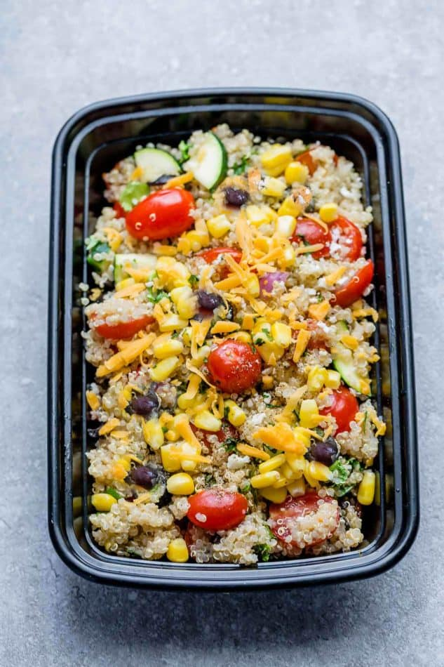 Mexican Quinoa Salad with delicious grilled corn and zucchini make the perfect summery meal. Best of all, it's so easy to customize and is loaded with cucumbers, black beans, cherry tomatoes,, red onions and optional shredded cheese and then tossed in a sweet and tangy honey lime vinaigrette.
