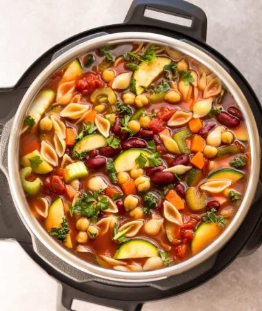 Instant Pot Minestrone Soup makes the perfect homemade easy comforting meal. Best of all, it's an easy set and forget recipe and is so much healthier and better than Olive Garden's version! Made entirely in your pressure cooker and is SO delicious!