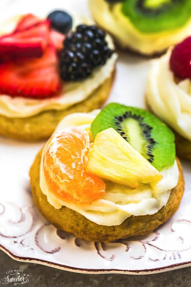 Mini Fruit Pizza topped with a slice of mandarin orange, pineapple, and kiwi