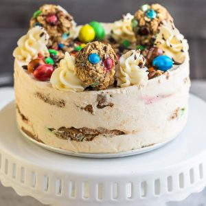 Side view of a round Monster Oatmeal Cookie Icebox Cake on a cake pedestal