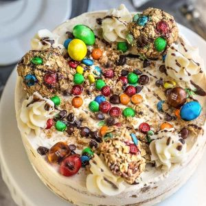 Top view of a round Monster Cookie Icebox Cake on a cake pedestal