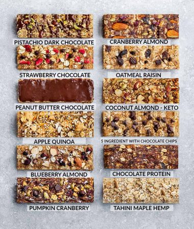 12 Granola Bars Lined up on a Gray Counter with Flavor Labels on Each One