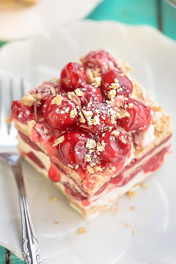No Bake Cherry Cheesecake Icebox Cake is the perfect easy make ahead dessert! Best of all, it's made with just 5 ingredients and amazing for barbecues, potlucks and holiday parties!