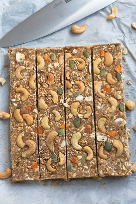 Top view of pumpkin oatmeal bars on with a knife