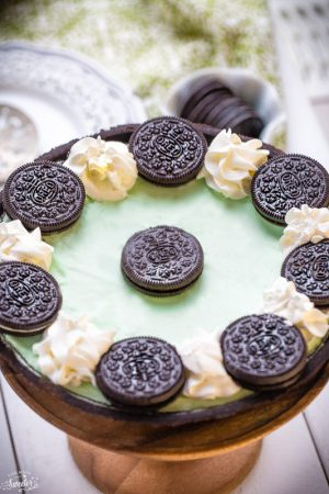 No Bake Chocolate Mint Oreo Pie is made with an easy Oreo cookie crust filled with a creamy cheesecake filling. Takes less than 10 minutes of prep and perfect for Pi Day and St. Patrick's Day!