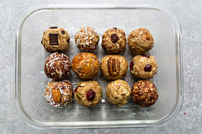12 No Bake Energy Bites in a clear glass rectangle container