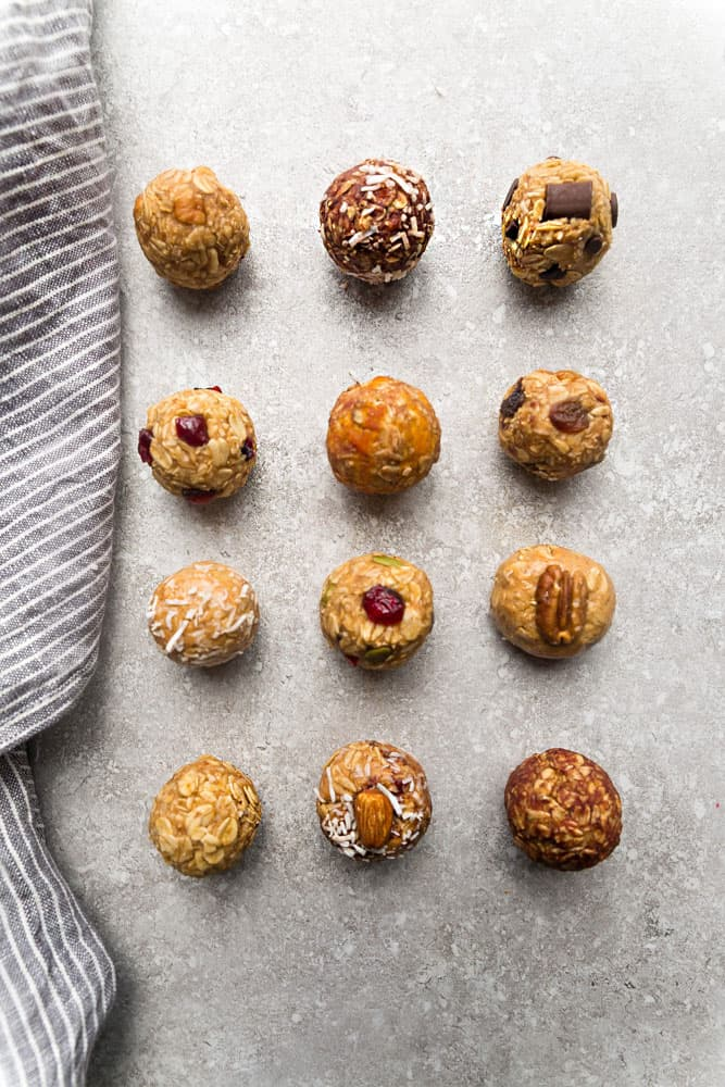 Twelve Ovenless Energy Bites with Various Flavors on a Counter Beside a Kitchen Towel