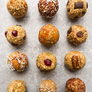 No Bake Energy Bites 12 Different Ways - the perfect easy and healthy no bake & tasty gluten free snacks for on the go or after a workout! Best of all, most of these delicious recipes have no refined sugar and are simple to customize & make ahead for meal prep to pack for school or work lunchboxes. Flavors include: 5 Ingredient, Almond Joy, Apple Cinnamon, Apricot, Banana, Carrot Cake, Coconut Almond Butter, Cranberry, Lemon, Mocha, Oatmeal Raisin, Pumpkin & Turtle Pecan