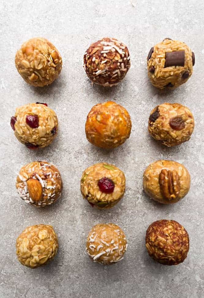 various no bake energy bites with cranberries, chocolate, almonds, cashews, and coconut