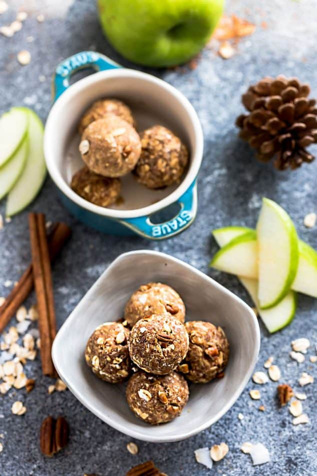 Apple Energy Bites - the perfect easy and healthy no bake snacks for on the go or after a workout! Best of all, no refined sugar and super easy to customize and make ahead for packing into school or work lunchboxes. Full of cozy fall and apple flavors with gluten free and nut free options.
