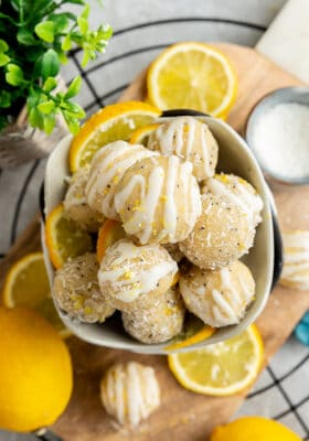Top view of a pile of No Bake Vegan Lemon Protein Balls stacked in a white bowl