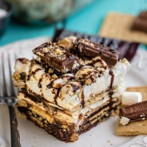 A square of No Bake S'mores Icebox Cake on a plate with a fork