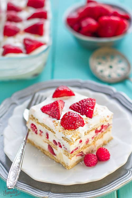 No Bake Strawberry Cheesecake Icebox Cake is the perfect easy dessert for potlucks, barbecues, cookouts, picnics, baby showers, Mother's Day or Fourth of July parties. Best of all, this recipe is great for make-ahead with only 10 minutes of prep time containing fresh whipped cream, cream cheese & graham crackers.