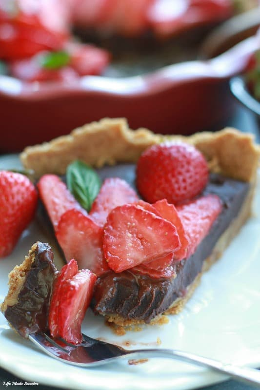 No-Bake Strawberry Chocolate Ganache Tart makes an easy & decadent dessert perfect for summer gatherings.