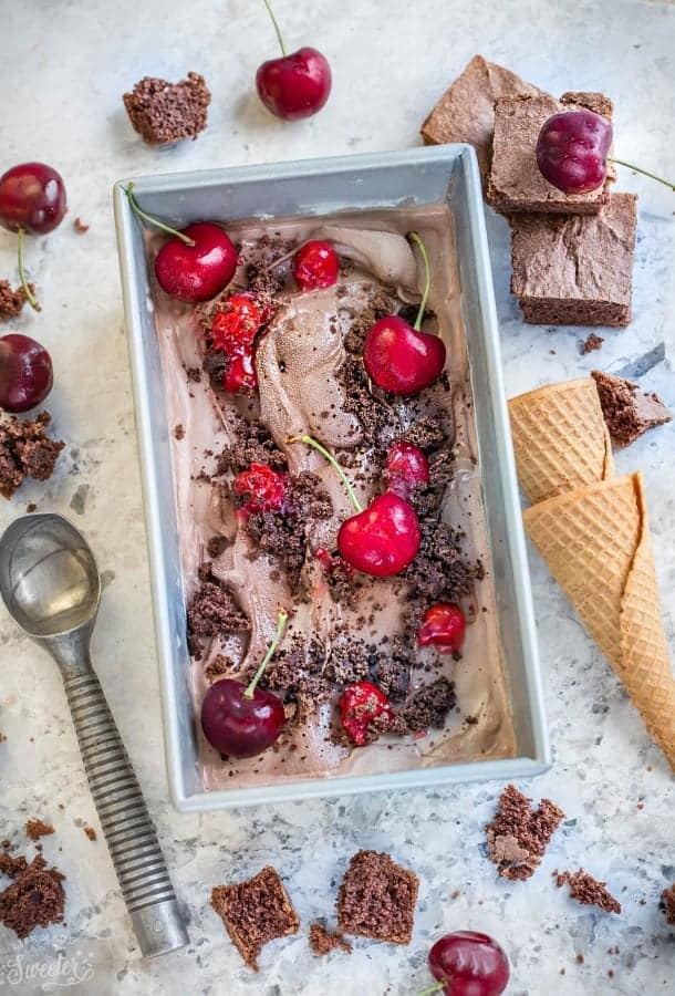Top view of No Churn Black Forest Ice Cream topped with cherries in a rectangular pan