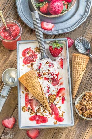 No Churn Strawberry Cheesecake Ice Cream is the perfect frozen sweet treat for summer. Best of all, super simple to make and no ice cream maker needed! Full of delicious fresh strawberries, cream cheese and crunchy granola streusel clusters.