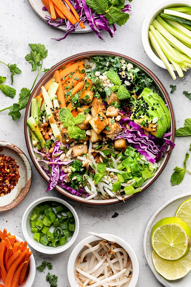 Overhead view of a Nourish Bowl surrounded by bowls of individual ingredients