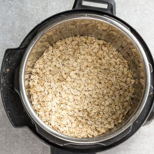 Top view of steel cut oats in a instant pot on a grey background