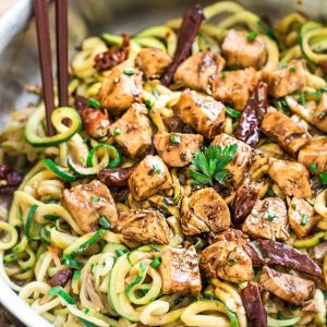 Close-up view of Kung Pao Chicken Zoodles {Zucchini Noodles} in a skillet