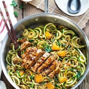 Top view of Teriyaki Chicken Zoodles in a pan with chopsticks