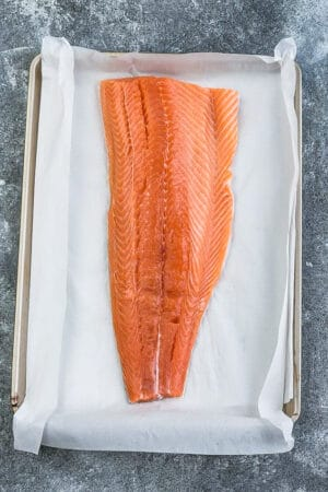 Top view of easy baked salmon on a baking sheet over parchment paper