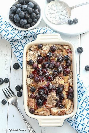 Overnight Blueberry French Toast Bak - an easy and delicious baked French Toast bursting with blueberries and cream cheese. Perfect for breakfast, brunch or even dinner.
