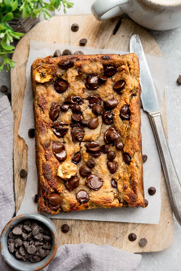 Paleo banana bread loaf garnished with chocolate chips