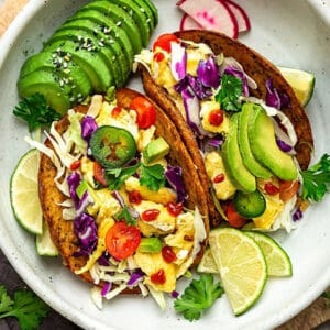 Overhead image of breakfast tacos with avocado,