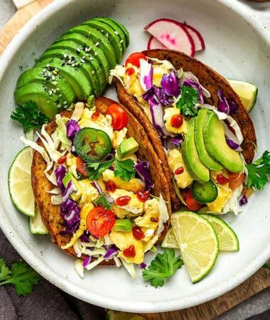 Overhead image of breakfast tacos with avocado,
